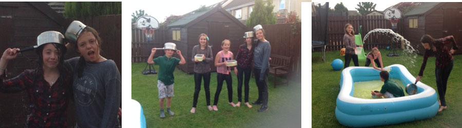 Amaia ,Esti, Katie,Daniel and Ameilia having a water fight in the back garden